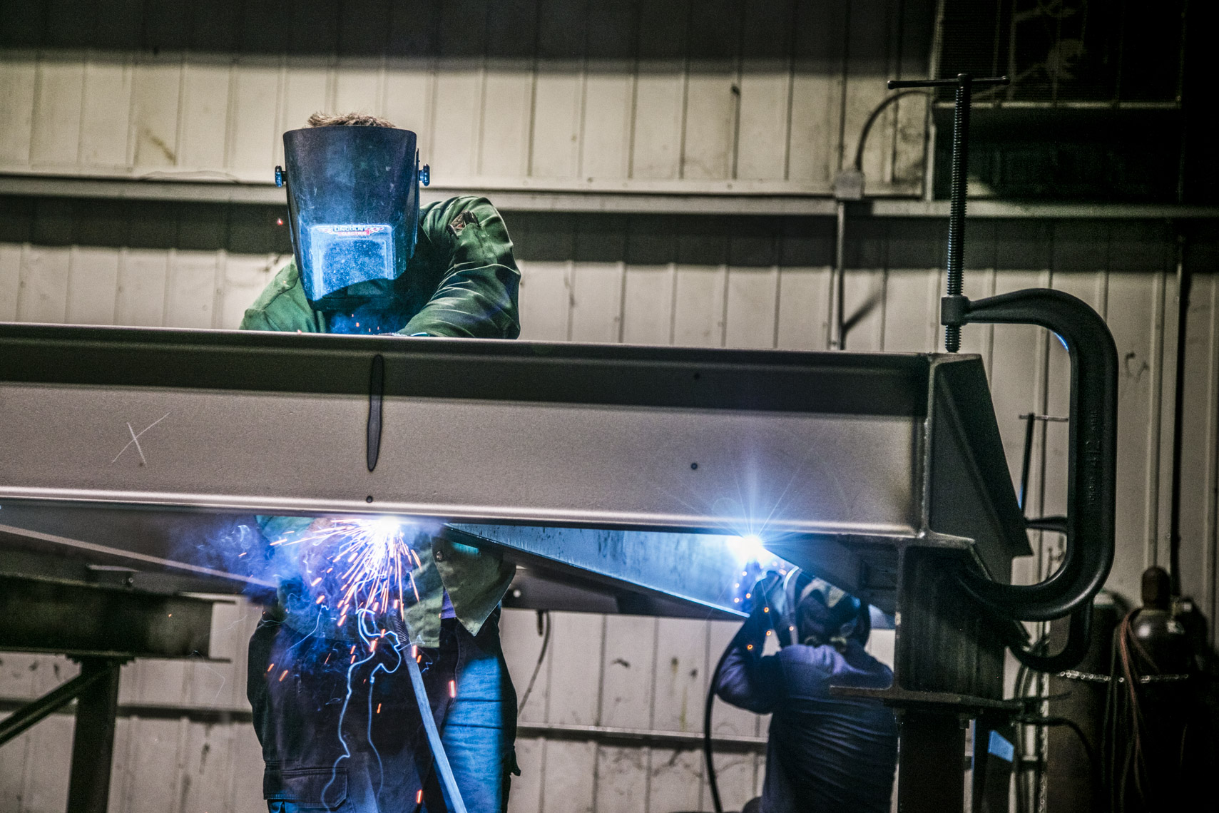 Workers welding metal at a small business in West Virginia