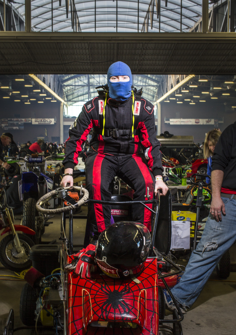 Portrait of teen preparing to race go-karts