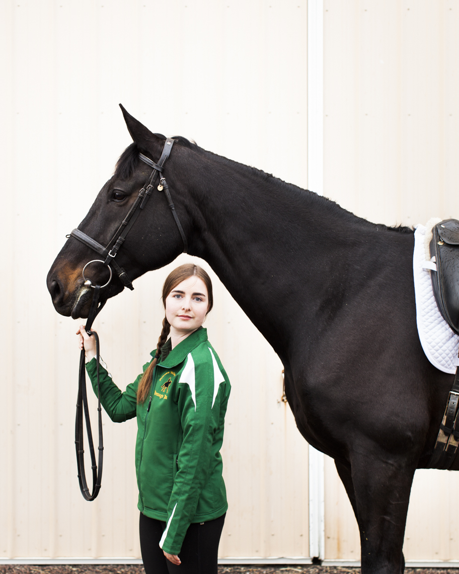 Portrait of female equestrian athlete and her horse