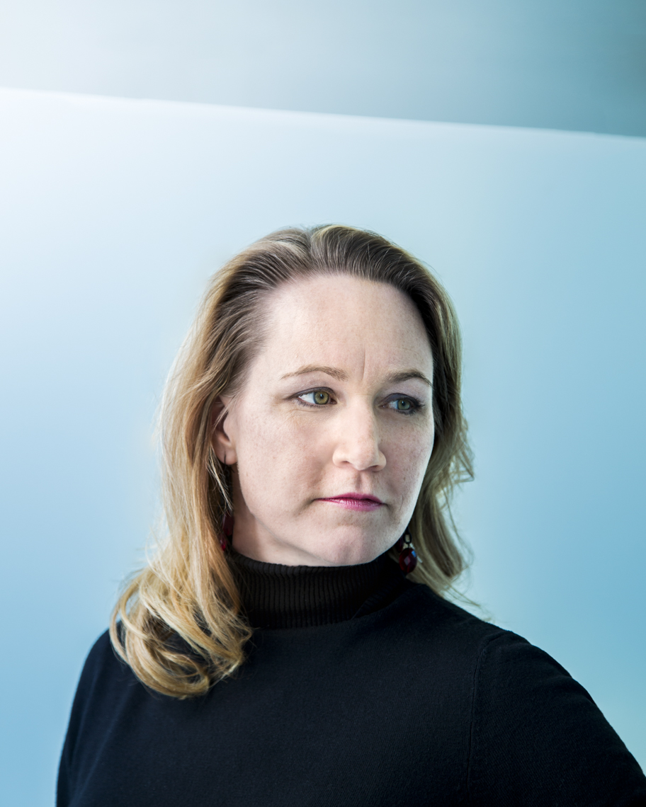 Portrait of female business person against blue background