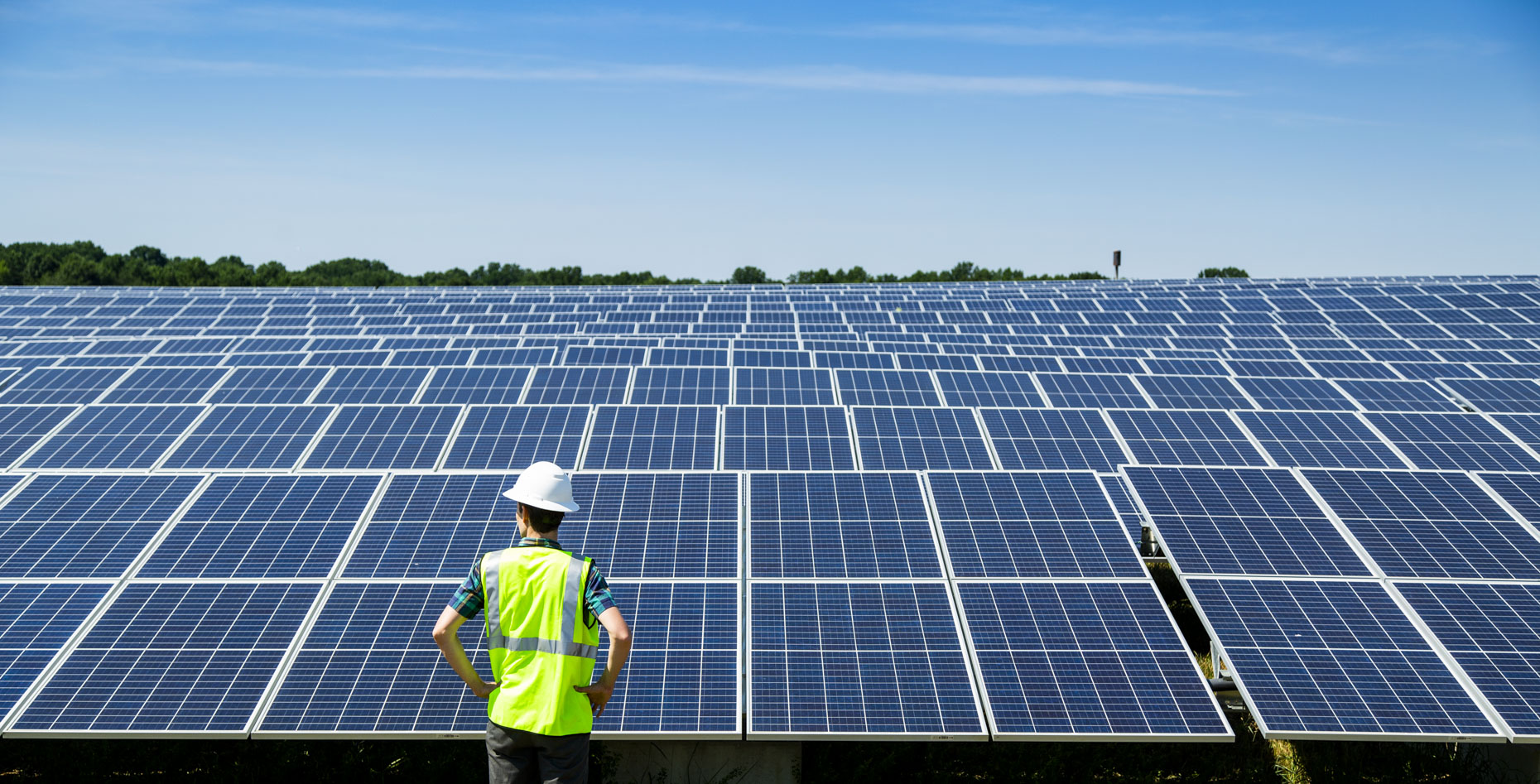 A worker surveys solar panels at a solar energy company in the United States.